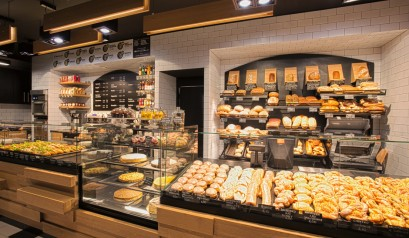 Creative Polish Bakery Uses Recycled Baking Trays as Wall Tiles | The Polish architects Mode:lina renewed a centenarian bakery in Toruń, Poland, with recycled baking trays as wall tiles.